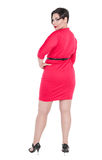 Beautiful plus size woman in red dress posing Royalty Free Stock Photography