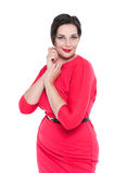 Beautiful plus size woman in red dress posing isolated Royalty Free Stock Photos