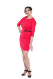 Beautiful plus size woman in red dress posing isolated Stock Images
