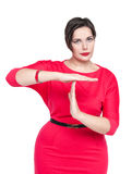 Beautiful plus size woman in red dress showing time out gesture Stock Photo