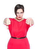 Beautiful plus size woman in red dress with thumbs down gesture Royalty Free Stock Photos