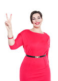 Beautiful plus size woman in red dress with victory isolated Stock Image