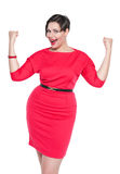 Beautiful plus size woman in red dress with yes gesture isolated Royalty Free Stock Photo