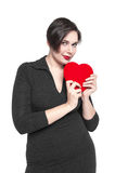 Beautiful plus size woman with red heart isolated Stock Photo