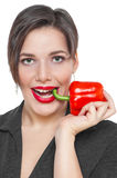 Beautiful plus size woman with red pepper isolated Royalty Free Stock Images