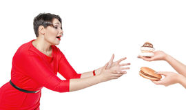 Beautiful plus size woman seduced with hamburger and pastry Stock Image