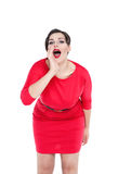 Beautiful plus size woman shouting through megaphone shaped hand. S isolated Royalty Free Stock Photos