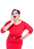 Beautiful plus size woman shouting through megaphone shaped hand Stock Image
