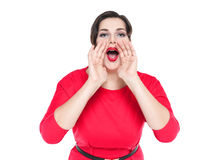 Beautiful plus size woman shouting through megaphone shaped hand Stock Photos