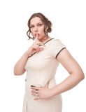 Beautiful plus size woman showing quiet sign Royalty Free Stock Images