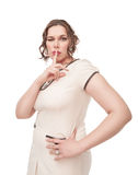 Beautiful plus size woman showing quiet sign and winking Stock Images