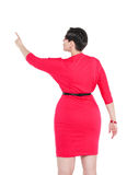 Beautiful plus size woman showing on something by finger Stock Images