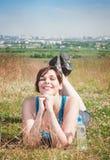 Beautiful plus size woman in sportswear lying on the meadow outd Stock Image