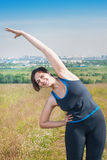 Beautiful plus size woman stretching outdoor Royalty Free Stock Images