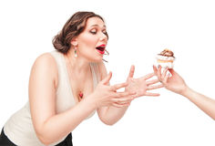 Beautiful plus size woman temptating with pastry Royalty Free Stock Images