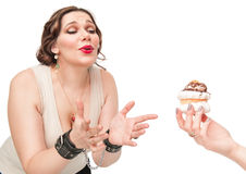 Beautiful plus size woman temptating with pastry Stock Photography
