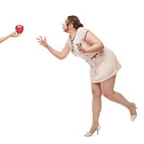 Beautiful plus size woman wish for apple Stock Photos
