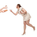Beautiful plus size woman wish for unhealthy food Stock Images