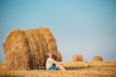 Beautiful Plus Size Young Woman In Shirt Sit Near Hay Bales In S. Ummer Field Meadow At Blue Sly Background Stock Image