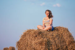Beautiful Plus Size Young Woman In Shirt Sit Near Hay Bales In S Stock Photography