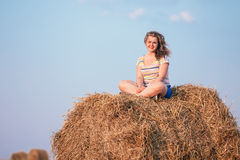 Beautiful Plus Size Young Woman In Shirt Sit Near Hay Bales In Summer Royalty Free Stock Images