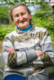 Beautiful 80 plus year old senior woman posing for a portrait in her garden.  royalty free stock photos
