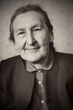 Beautiful 80 plus year old senior woman posing for a portrait in her house Stock Photography