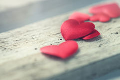 Beautiful plush hearts on a wooden background, vintage toning, l. Ove or valentine`s day concept royalty free stock images