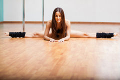 Beautiful pole dancer doing a split Stock Photography