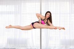 Beautiful pole dancer Royalty Free Stock Photography