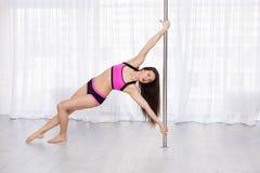 Beautiful pole dancer Stock Photography