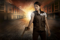Beautiful police woman holding gun royalty free stock photos