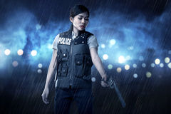 Beautiful police woman holding gun. Ready to fire Royalty Free Stock Photos