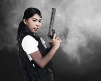 Beautiful police woman holding gun Royalty Free Stock Photography