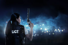 Beautiful police woman holding gun stock photos