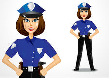 Beautiful policewoman holding hands on her hips Stock Images