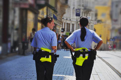 Beautiful policewomen in the streets of the city Royalty Free Stock Image