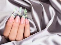 Beautiful polished nails. Female hands displaying beautiful polished nails Stock Photos