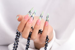 Beautiful polished nails. Female hands displaying beautiful polished nails Royalty Free Stock Images
