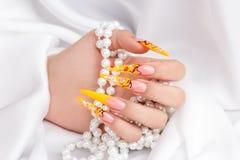 Beautiful polished nails. Female hands displaying beautiful polished nails Stock Photo