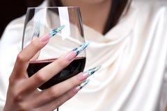 Beautiful polished nails. Female hands displaying beautiful polished nails Royalty Free Stock Photography