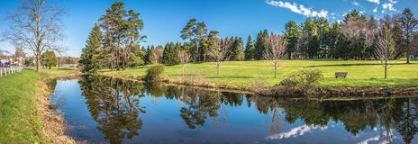 Beautiful Pond Reflections. Pond in Northampton City, State of Massachusetts, Beautiful reflections in the water, panoramic view stock image