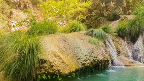 Beautiful pond with waterfall at Poilimnio in Greece stock footage