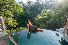 Beautiful young balinese girl at pool outdoor Royalty Free Stock Images