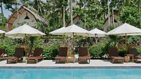 Beautiful Pool Palm Resort Nusa Penida Indonesia Vacation Travel 4k. Footage of a pool in a beautiful resort full of palm trees. Shot in 4k stock video footage