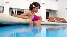 Beautiful pool woman stock footage