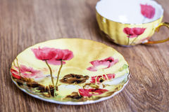 Beautiful porcelain cup and  plate Stock Photos