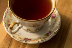 Beautiful porcelain cup of tea on the table royalty free stock photo