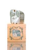 Beautiful porcelain elephant on box. Isolated Royalty Free Stock Images