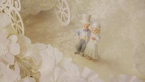 Beautiful porcelain figurines of the newlyweds. Close up. Beautiful jewelry. Event decor stock video footage
